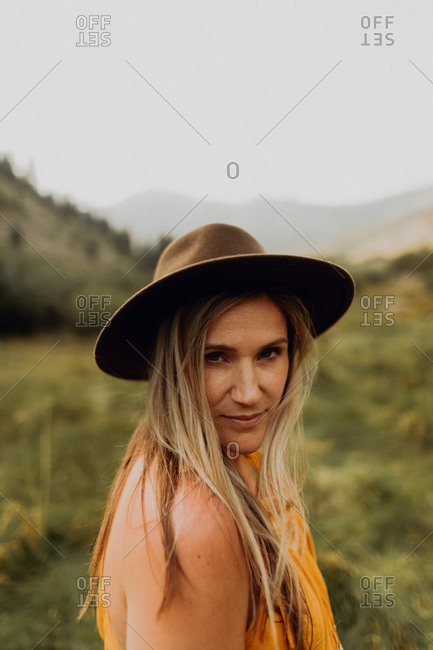 Mid adult woman in felt hat in rural valley, portrait, Mineral King, California, USA