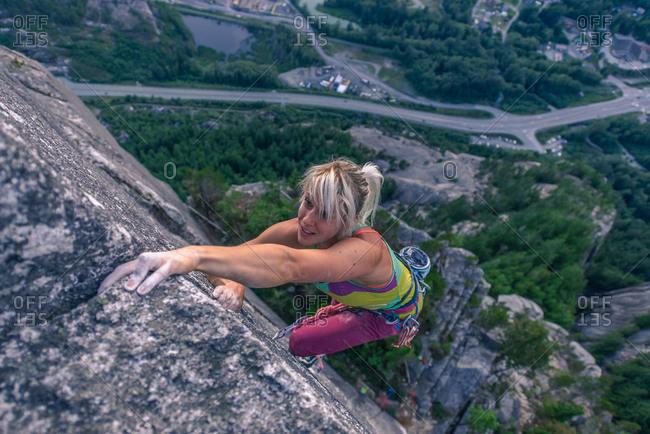 Rock climber ascending Heatwave, The Chief, Squamish, Canada