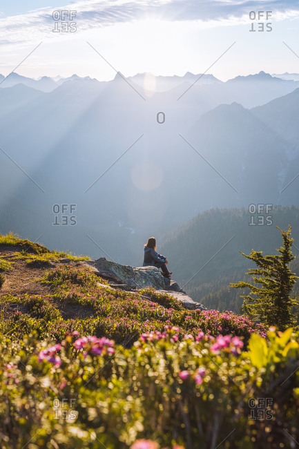 Female hiker enjoying sun on peak, Winchester Mountain, North Cascades, Washington