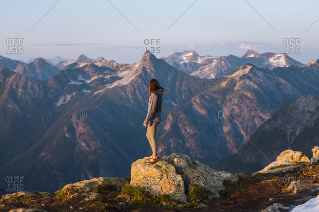 Female hiker enjoying view on peak, Winchester Mountain, North Cascades, Washington, USA