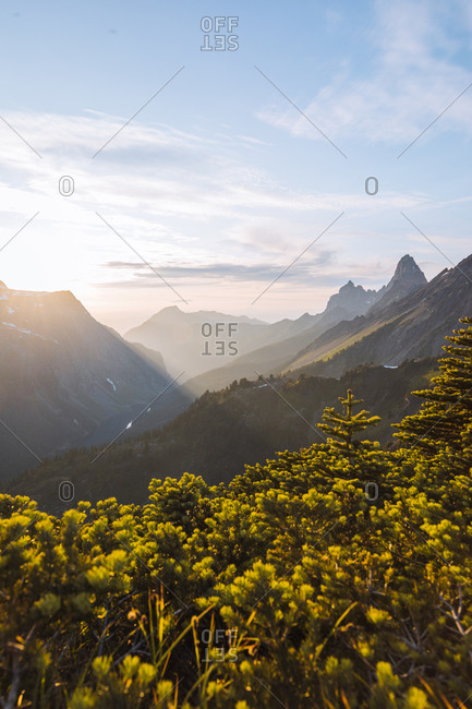 Sun flare over Winchester Mountain, North Cascades, Washington, USA