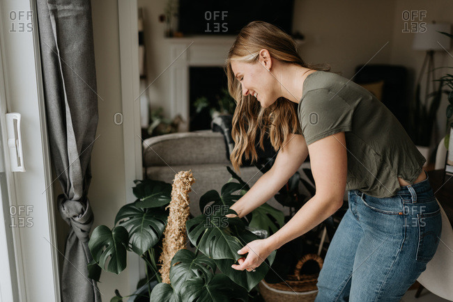 Woman caring for house plants