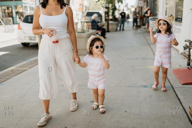 Family of three taking walk in city