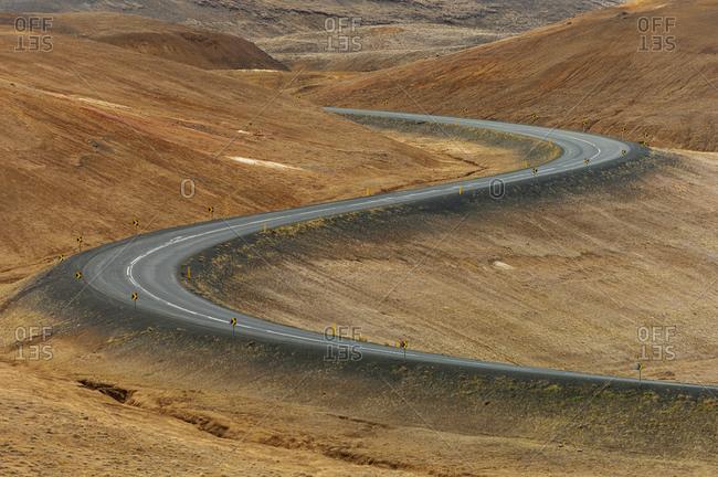 Windy road, Namafjall mountain, Myvatn lake area, Iceland