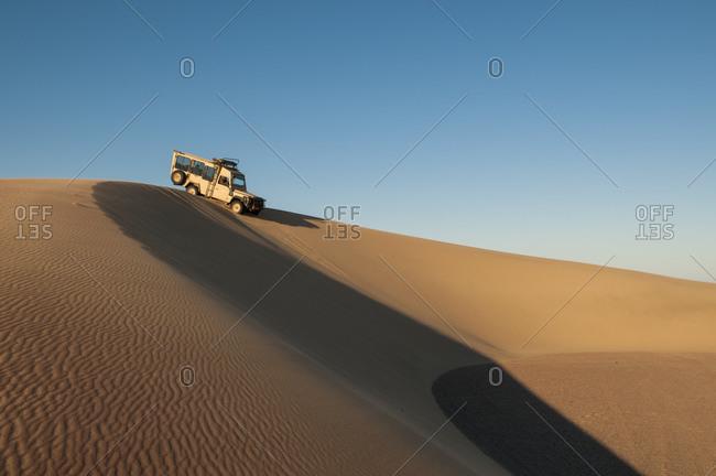 Off-road vehicle on sand dunes, Skeleton Coast National Park, Namibia