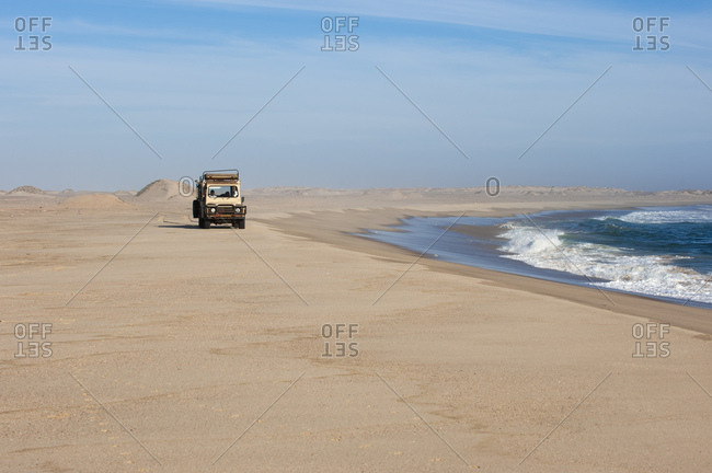 Off-road vehicle on sand dunes, Skeleton Coast beach, Skeleton Coast National Park, Namibia