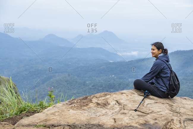 Female hiker on Little Adam's peak, Ella, Sri Lanka