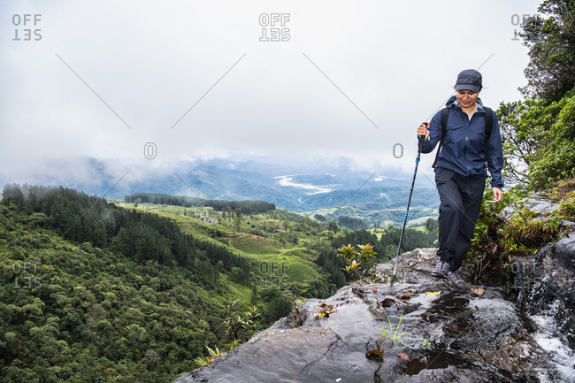 Woman hiking in highlands, Madulkelle, Sri Lanka
