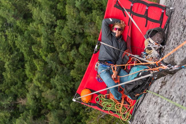 Climber resting on portaledge, trad climbing, Stawamus Chief, Sea to Sky corridor, Squamish, British Columbia, Canada