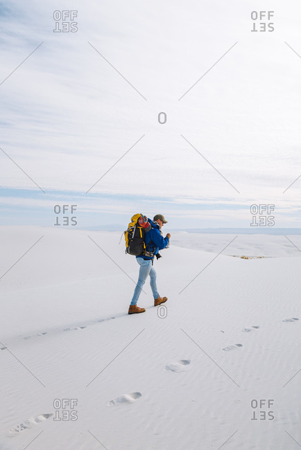 Hiker crossing White Sands National Monument, New Mexico, US