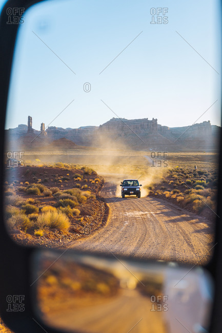 Off road vehicle driving through Valley of the Gods, Utah, US
