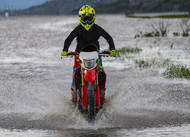 Woman riding her off road bike, Nakhon Ratchasima, Thailand
