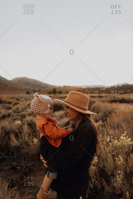 Mother and baby girl bonding, Kennedy Meadows, California, US