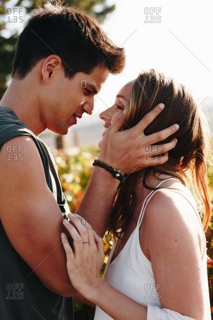 Couple looking at each other intimately outdoors