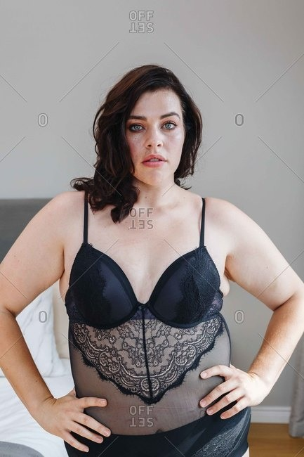 Woman in lingerie posing in bedroom