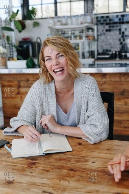 Businesswoman laughing at office meeting