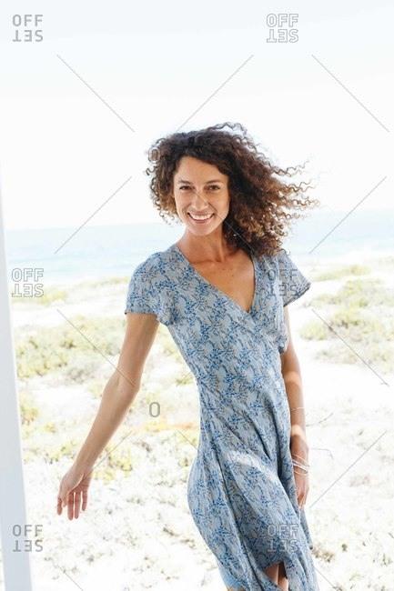 Woman enjoying breeze by beach