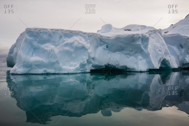 Reflections of ice shelf, Skontorp Cove, Paradise Bay, Antarctica
