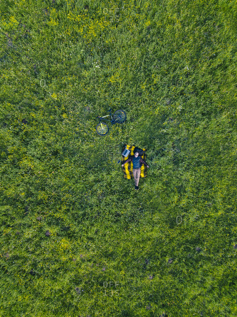 Man lying on grass- aerial view