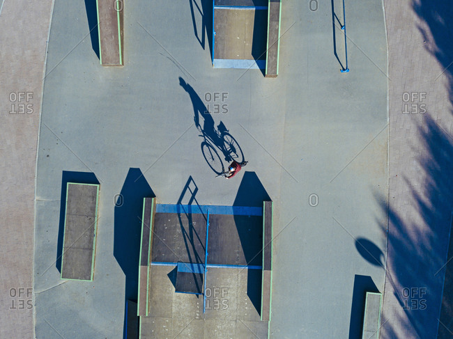 Man cycling in skate park- aerial view