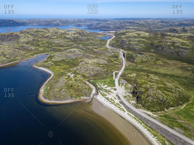 Russia- Murmansk region- Kolsky District- Teriberka- Sea coast and road- aerial view