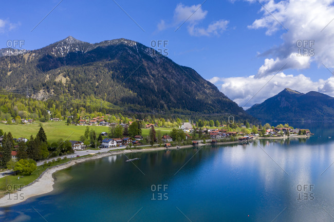Germany- Bavaria- Kochel- Village on shore of Lake Walchen with Herzogstand mountain in background