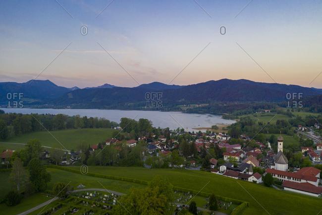 Germany- Bavaria- Upper Bavaria- Gmund am Tegernsee- Village and lake at sunrise