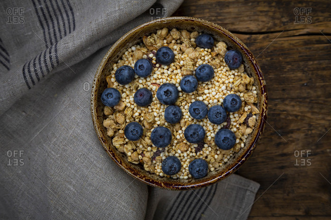 Bowl of granola with blueberries and quinoa