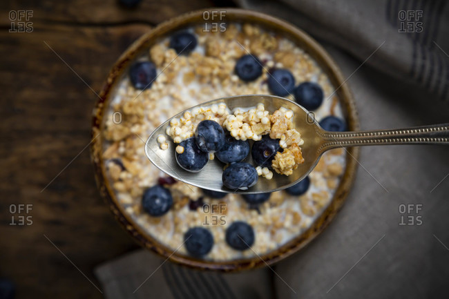 Spoon of granola with blueberries and quinoa