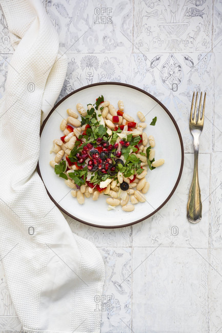 Oriental bean salad (cannellini beans- fennel- bell pepper- black olives- pomegranate seeds- mint- parsley)