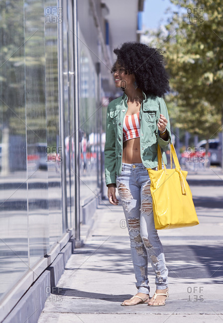 Young woman looking into shop window