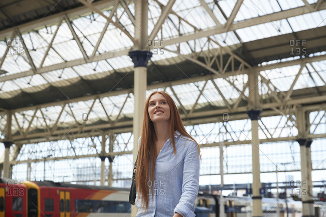 Thoughtful young woman walking at railroad station