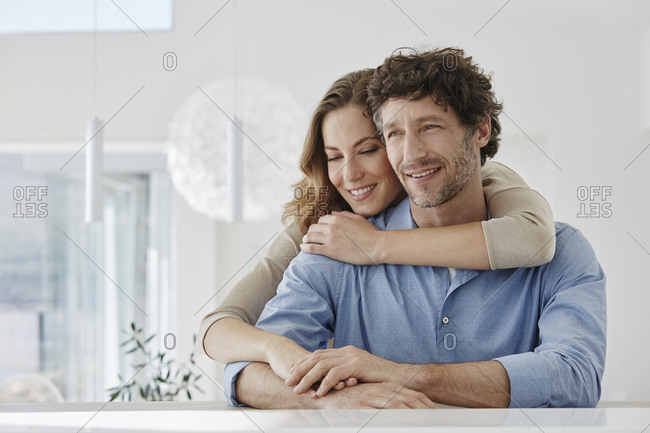 Portrait of happy affectionate couple in a villa