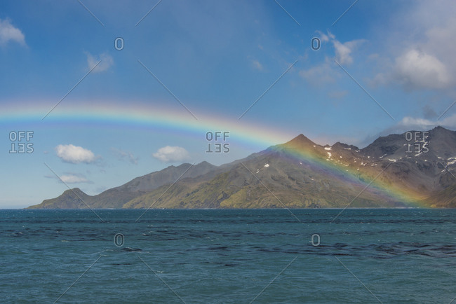 UK- South Georgia and South Sandwich Islands- Rainbow over Atlantic Ocean