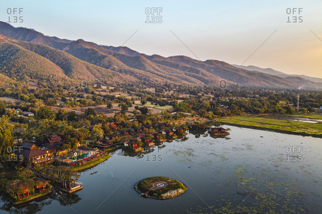 Myanmar- Shan State- Nyaungshwe Township- Aerial view of town on shore of Inle lake at dusk