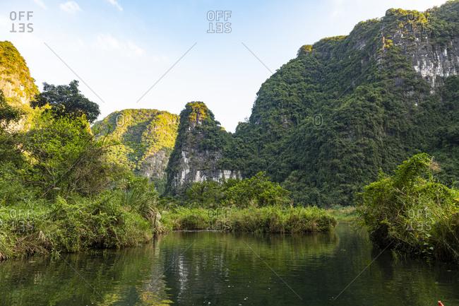 Vietnam- Limestone mountains at Trang An Scenic Landscape Complex