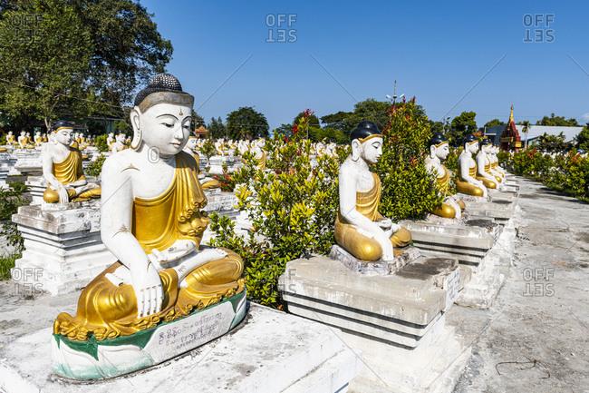 Myanmar- Kachin state- Aung Zay Yan Aung Pagoda- Buddha statues outside temple