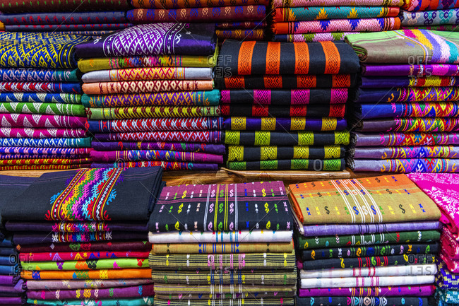 Myanmar- Kachin state- Colorful clothes for sale