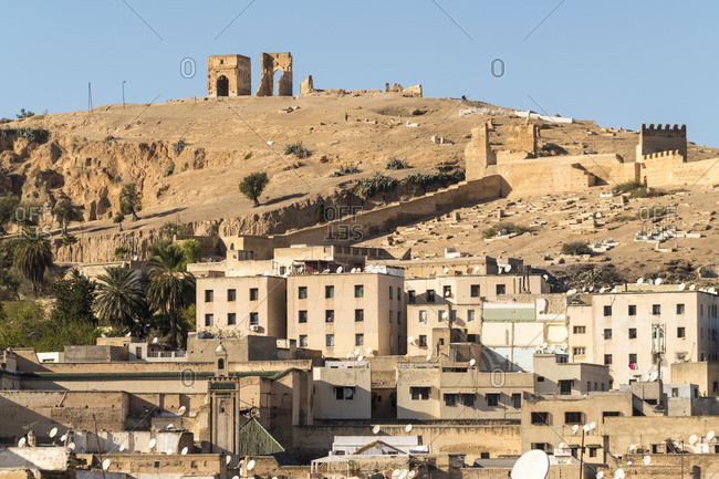 November 18, 2017: Morocco- Fez- Medina houses with Marinid Tombs in background