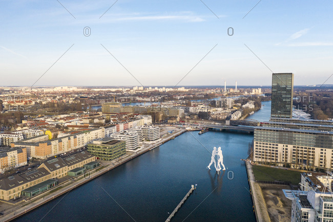March 17, 2020: Germany- Berlin- Aerial view of Molecule Man sculpture standing in middle of river Spree canal
