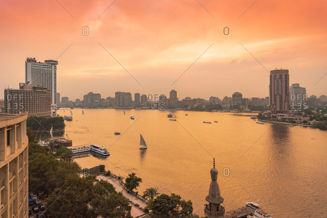 Egypt- Cairo- Nile with skyline and downtown area from Garden City at sunset