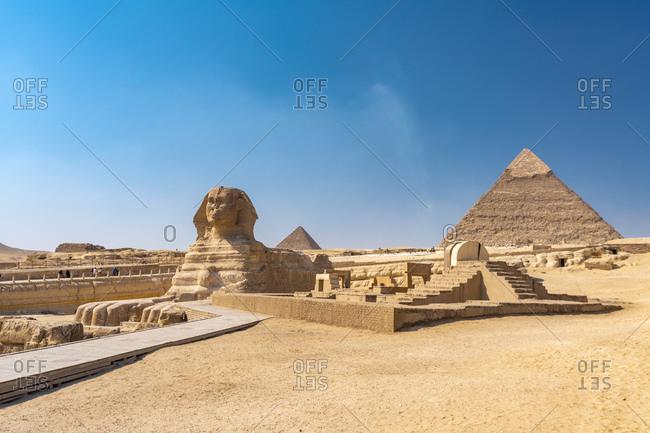 Egypt- Giza Governorate- Giza- Great Sphinx of Giza and Giza Pyramids