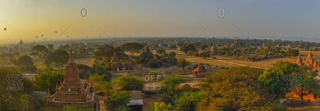 Myanmar- Mandalay Region- Bagan- Panorama of ancient Buddhist temples at dawn
