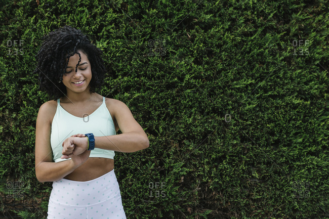 Young athletic woman checking the time