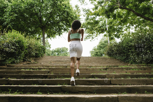 Rear view of female jogger on steps