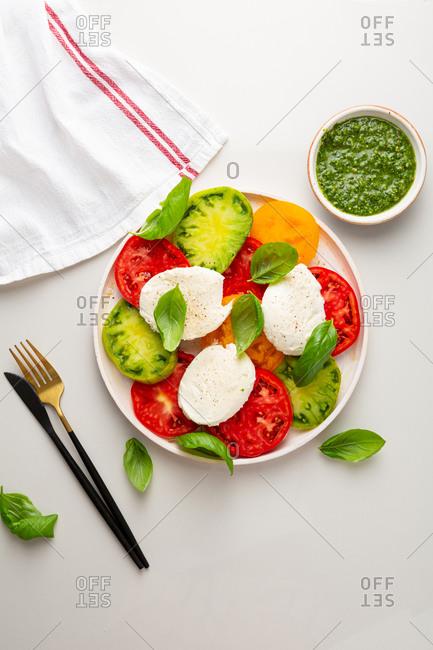 Overhead view of tomato caprese salad