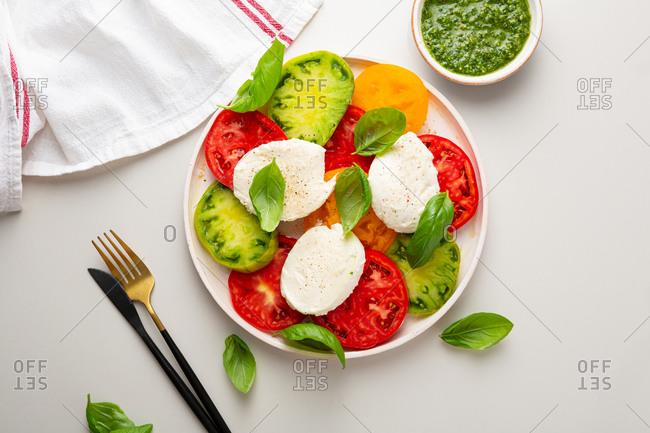 Overhead view of heirloom tomato caprese salad