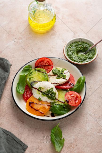 Close up of Heirloom tomato salad with pesto