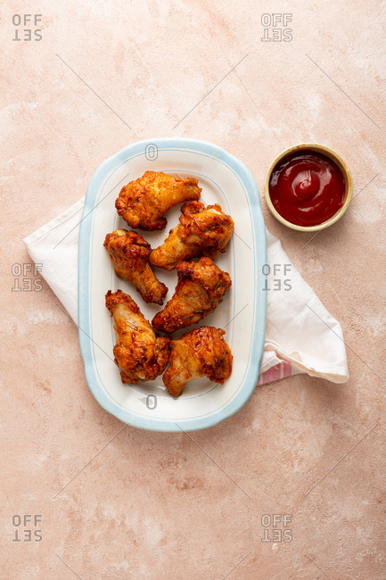 Chicken wings on serving plate