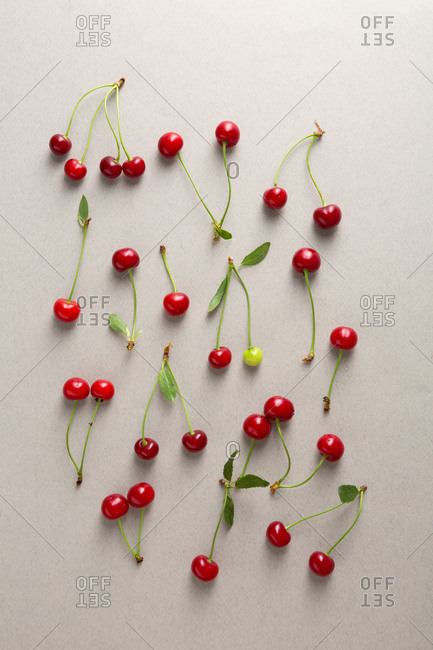 Overhead view of cherries pattern on gray background